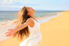 Free happy woman on beach. Enjoying nature. Natural beauty girl outdoor in freedom enjoyment concept. Mixed race Caucasian Asian girl posing on travel vacation stock image