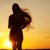 Free Happy Woman Enjoying Nature. Beauty Girl Outdoor. Freedom concept. Beauty Girl over Sky and Sun. Sunbeams. Enjoyment royalty free stock image