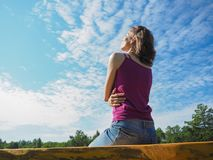 Free happy woman enjoying nature. Beauty girl outdoor. Beauty girl over sky and sun. Stock Images
