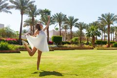 Free happy woman enjoying nature. Freedom concept. Beauty Girl over Sky and Sun in vacation. Enjoyment.  royalty free stock photography