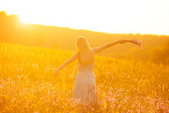 Free happy woman. Enjoying nature. Toned in warm colors Royalty Free Stock Photos