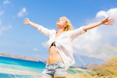 Free Happy Woman Enjoying Sun on Vacations. Royalty Free Stock Photography