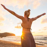 Free Happy Woman Enjoying Sunset on Sandy Beach Stock Photos