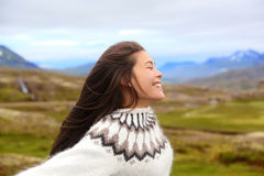 Free happy woman on Iceland in Icelandic sweater Stock Image