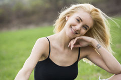 Free happy woman in spring park smiling Royalty Free Stock Photos