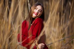 Free happy young woman. Beautiful female with long healthy hair enjoying sun light in park at sunset. Spring, autumn Stock Photography