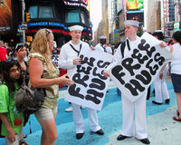 Free Hugs. Sailors holding free hugs signs in Stock Image