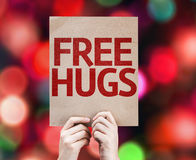 Free Hugs written on colorful background with defocused lights royalty free stock photos