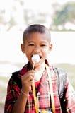 Free Ice-cream. The child is happy because he take a free ice-cream. The children in a school in Korat , Thailand stock photos