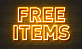 Free items neon sign on brick wall background. Royalty Free Stock Photography