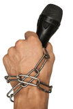 The free journalism. Hand with microphone rewind chains, symbolizing freedom of speech Royalty Free Stock Photos