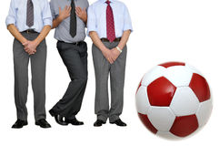 Free kick. Barrier of businessmen with soccer ball waiting for a free kick isolated in white Stock Photo