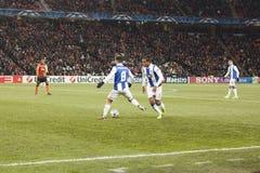 Free-kick. DONETSK, UKRAINE - NOVEMBER 23, 2011:  Players of Porto João Moutinho (No. 8) and Álvaro Pereira (No. 5) play a free-kick in the match of the Royalty Free Stock Image