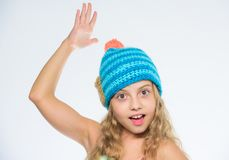 Free knitting patterns. Knitted hat with pompon. Girl long hair happy face white background. Kid wear warm soft knitted. Blue hat. Difference between knitting stock photos