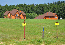 Free Land with Natural Gas Pipelines Ready for Install on the Summer Cottage Village Background. Stock Photography