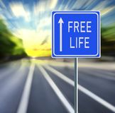 Free Life Road Sign on a Speedy Background with Sunset. royalty free stock images