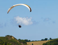 Free like a bird. Man paragliding against cloudy sky Stock Image