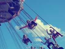 Free like a bird. Children enjoying amusement park rides that makes you feel free as a bird Stock Images