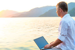Free man with a laptop Stock Images