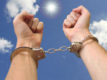Free me!. Man hains in handcuffs on a sky background stock images