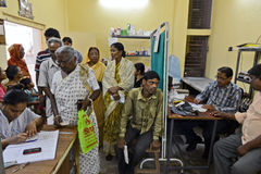 Free Medical Check-up. Patient waiting for free medical check-up in the Kolkata's slum area Royalty Free Stock Photo