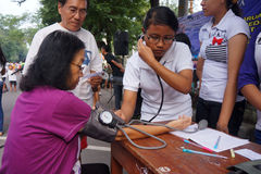 Free medical treatment. Medical personnel are conducting free medical treatment to people in a park in the city of Solo, Central Java, Indonesia royalty free stock photos