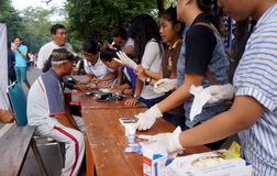 Free medical treatment. Medical personnel are conducting free medical treatment to people in a park in the city of Solo, Central Java, Indonesia stock photo