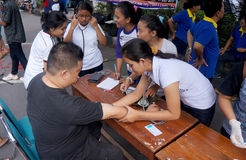 Free medical treatment. Medical personnel are conducting free medical treatment to people in a park in the city of Solo, Central Java, Indonesia royalty free stock photography