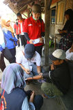 Free medical treatment. Medical teams conduct free medical treatment to people in slums in the city of Solo, Central Java, Indonesia royalty free stock images
