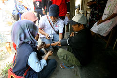 Free medical treatment. Medical teams conduct free medical treatment to people in slums in the city of Solo, Central Java, Indonesia stock images
