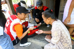 Free medical treatment. Medical teams conduct free medical treatment to people in slums in the city of Solo, Central Java, Indonesia stock photography