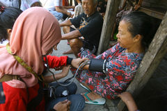 Free medical treatment. Medical teams conduct free medical treatment to people in slums in the city of Solo, Central Java, Indonesia royalty free stock photography