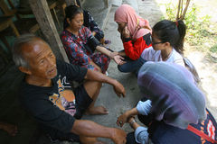 Free medical treatment. Medical teams conduct free medical treatment to people in slums in the city of Solo, Central Java, Indonesia royalty free stock image