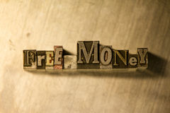 Free money - Metal letterpress lettering sign Royalty Free Stock Photos