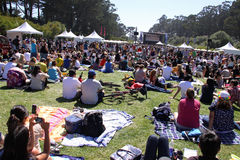 Free Outdoor San Francisco Concert. Music fans enjoy a perfect summer day in San Francisco's Golden Gate Park as they listen to music at the Alice@97.3 Stock Photo