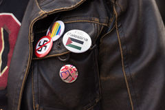 Free Palestine, Anti-Swastika, LGBTQ pins on activist jacket Royalty Free Stock Image