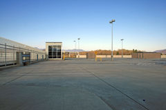 Free Parking. Wide open and empty parking lot / deck with blue sky Stock Images