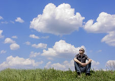 The free person. The person sitting on the earth against the sky stock photos