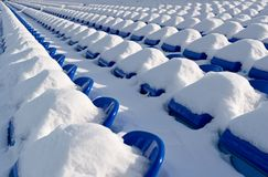 Free places are not present!. Tribunes of stadium after a strong snowfall. Stadium for game in football(soccer Royalty Free Stock Photos