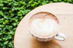 Free pour hot coffee latte serving on table Royalty Free Stock Photos