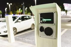 Free public charger of electric vehicles for free use for supermarket customers