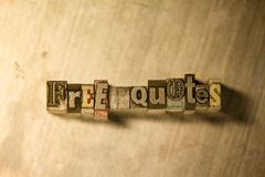 Free quotes - Metal typography lettering sign. Lead metal 'Free quotes' letterpress text on wooden background Royalty Free Stock Photo