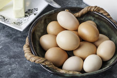 Free range brown eggs in a bowl. Bowl of fresh free range brown chicken eggs ready for baking Stock Image
