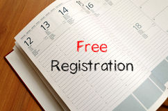 Free registration write on notebook Stock Photography