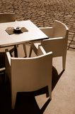 Free restaurant table with chairs on the street. Free restaurant table with three chairs on the street Royalty Free Stock Image