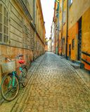Free ride. Abstract photo wallpaper background colors bicyle orange green photos exploring urban tourist view narow   photography blur wallking discover secret royalty free stock photo