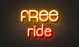 Free ride neon sign on brick wall background. Royalty Free Stock Image