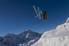 Free ride snow jumping. A professional freerider in action Royalty Free Stock Images