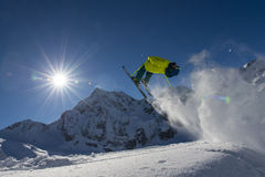 Free ride snow jumping. Ski jumping backflip in the alps Stock Images