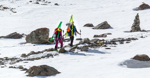 Free-riders ski climbers at the mountain summit Royalty Free Stock Image